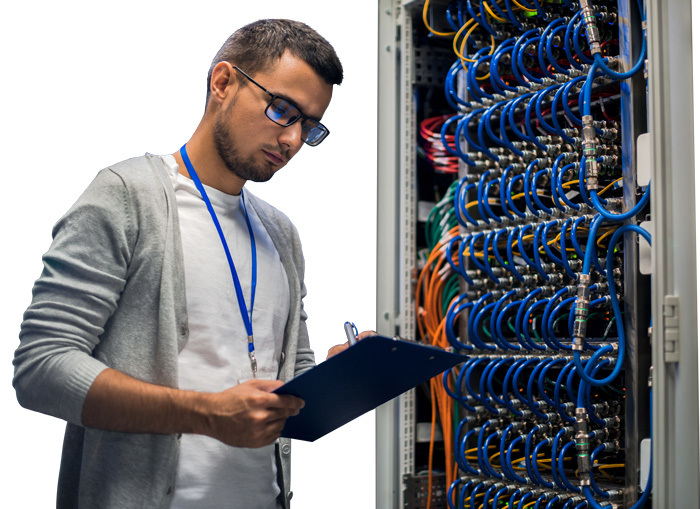 engineer inspecting a network cabinet